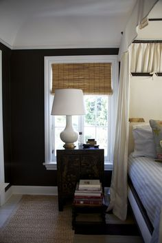 Would usually shy away from this dark color, but the ceiling height and trim color seem to make all the difference.