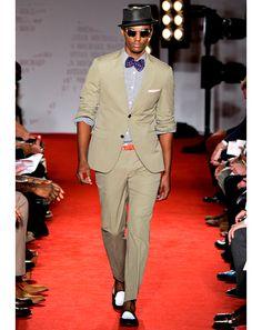 The khaki suit (muted) and purpel bowtie & orange belt (POP'd) by Michael Bastian