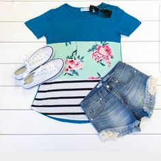 ad This top has a little bit of everything, stripes, solids and floral! A lightweight fun top for summer! Only $21 shipped