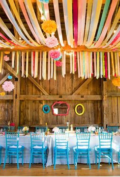 What a bright and fun way to dress up your reception space , buy hanging wide ribbons across the ceiling.