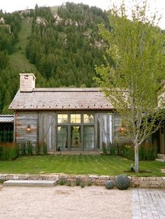 Beautiful little house, love the barn doors that can close over the large front windows.
