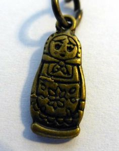 Russian Doll Metal Bronze Tone Key Ring By KeyParcels Gift Wedding favours Traditional by KeyParcels, http://www.amazon.co.uk/dp/B00K9PW0MW/ref=cm_sw_r_pi_dp_EWzGtb0698CCP
