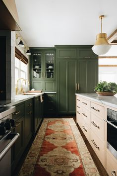 kitchen design with dark green cabinets and boho runner, gold kitchen pendants in dark kitchen, Fair Oaks — jean stoffer design kitchen cabinet Fair Oaks — jean stoffer design Green Kitchen Cabinets, New Kitchen, Kitchen Dining, Awesome Kitchen, Dark Cabinets, Kitchen Interior, Olive Green Kitchen, Green Kitchen Island, Beautiful Kitchen