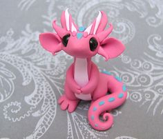 [Cute little pink polymer clay dragon by DragonsandBeasties on Etsy] This is adorable! I am planning on making my own cute clay dragons soon <3