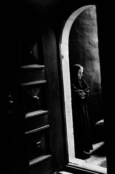 Abbas, The Orthodox monastery. A nun stands outside the church during lithurgy inside, Zica, Serbia, 1995.