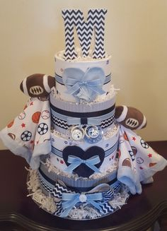 Sports themed diaper cake! Twin boys baby shower centerpiece gift.  Visit my Facebook page Simply Showers for more pics and orders. Kim