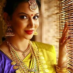 South Indian bride. Gold Indian bridal jewelry.Temple jewelry. Jhumkis.Yellow silk kanchipuram sari.Braid with fresh jasmine flowers. Tamil bride. Telugu bride. Kannada bride. Hindu bride. Malayalee bride.Kerala bride.South Indian wedding. Pinterest: @deepa8