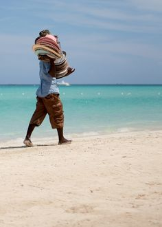 Hat vendor on the beach in Negril, Jamaica @LunaSeaInn in #Bluefields #Jamaica a short drive to #Negril