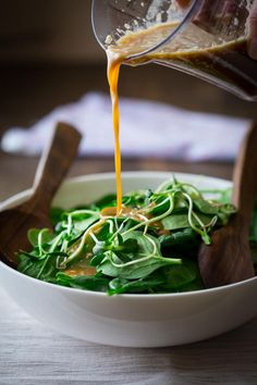 Healthy sesame dressing recipe with a bit of orange juice added to keep the calories in check. Vegan and gluten-free.