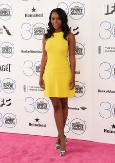 Aja Naomi King beamed in an ALC yellow Gia dress and Kurt Geiger London 'Britton' Pump in Natural Snake.