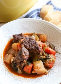 Gluten Free Beef Stew - Nearly Whole30 approved (just skip the wine), thickened with potatoes, and extra veggies make this simple stew satisfying and healthy all at once.