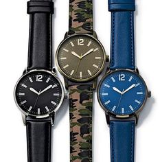 """While Supplies Last. 9 1/2"""" L strap.Black leatherlike band/silvertone caseCamouflage fabric band/brass-tone caseBlue leatherlike band/gunmetal-color case"""