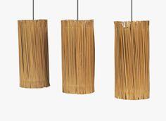Jean Royère 1902 - 1981 SUITE DE TROIS SUSPENSIONS, 1954 A SET OF THREE CANVAS CEILING LAMPS BY JEAN ROYÈRE, 1954 de forme cylindrique en rabanne et toile Hauteur : 29,5 cm (11 1/2 in.) Diamètre : 13 cm (5 in.)