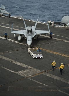 INDIAN OCEAN (June 10, 2013) Sailors reposition an F/A-18C Hornet assigned to the Blue Diamonds of Strike Fighter Squadron (VFA) 146 on the flight deck of the aircraft carrier USS Nimitz (CVN 68). Nimitz Strike Group is deployed to the U.S. 5th Fleet area of responsibility conducting maritime security operations and theater security cooperation efforts. (U.S. Navy photo by Mass Communication Specialist 3rd Class Raul Moreno Jr.