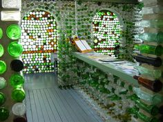 Cap-Egmont at The Bottle Houses (Maisons de Bouteilles). Made of over 25,000 different colored glass bottles.