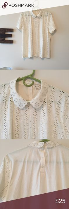 JCrew eyelit top Cutest thing!! Eyelit on the front but has a solid back. Peterson collar. Buttons on the back. PERFECT FOR SPRING J. Crew Tops Blouses