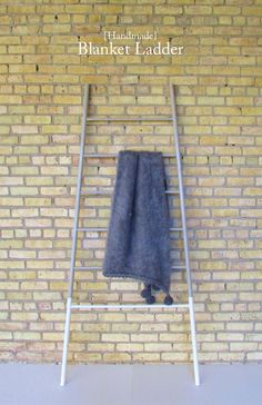 A DIY Blanket Ladder made of closet rods and wood dowels to store and display blankets | francoisetmoi.com