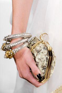 jeweled clutch, black nails, statement bracelets.