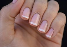 Natural-looking french manicure with OPI Are You Callin' Me a Lyre and Essie Marshmallow