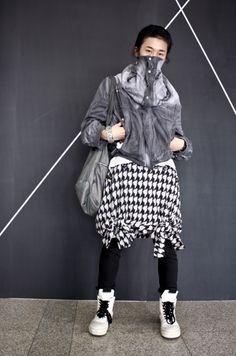 SEOUL. Jacket: Grey MARJAN PEJOSKI, Skirt: Black and White MERCIBEAUCOUP, Pants: Black VANDALIST, Shoes:White RICK OWENS High Top Sneakers, Bag: Grey REBLANK.