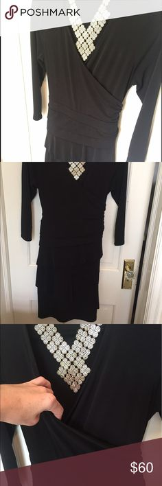 """Black Wrap Dress New York & Company black faux wrap dress. Very comfortable. I'm 5'9"""" and this hits me just below the knees. Ties in back for fitted look.  Never worn.  Size small but could fit a medium. New York & Company Dresses Midi"""