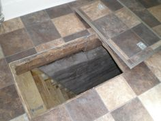 safe room door --- Secret trap door to crawlspace - With a little forethought and some extra work on new construction, you can make the tile match the cutout of your trap door, and make it much less conspicuous. Hidden Spaces, Hidden Rooms, The Farm, Crawl Space Door, Crawl Spaces, Passage Secret, Hidden Passageways, Secret Hiding Places, Panic Rooms