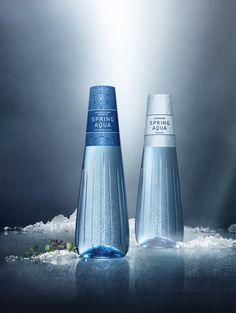 Design-lähdevesi koristaa ruokapöytää. Sopiiko Spring Aqua Premium mukaan juhlakattaukseesi?