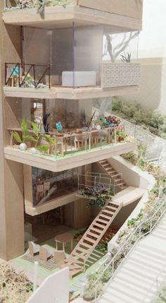 Maquetas de trabajo del estudio de arquitectura japonés Ondesign para un proyecto de vivienda colectiva con jardín en el centro de Tokio.