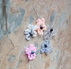 5 seed bead flowers can be bought as a mixed set or  pink,blue,orange,green,purple,white and clear ideal for scrap booking, card making, embellishments , kids craft, crafts and projects | Shop this product here: http://spreesy.com/SpryHandcrafted/3 | Shop all of our products at http://spreesy.com/SpryHandcrafted    | Pinterest selling powered by Spreesy.com