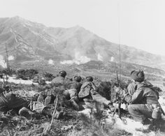 Personnel of Companies A and K 35th Infantry Regiment keep a sharp lookout for movement in the Communist-held area as U.N. forces bombard the vicinity with white phosphorous shells. Korea February 1 1951. [3600 x 2985]