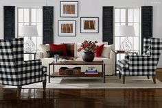 BLACK & WHITE LIVINGROOM: with red and wood case goods.