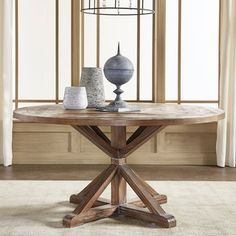 Add a unique touch to your dining room decor with this stunning Benchwright Rustic X-base 60-inch Round Dining Table. This table features an x-shaped wood frame and round top that makes this piece com