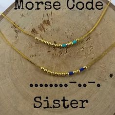 Cute, but I would put some spacers and longer beads for the dashes.