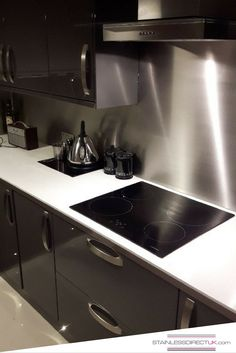 We loved doing this project! The stainless steel splashback goes very well with the dark grey cabinetry and gives the kitchen a modern, clean look.
