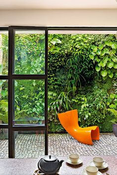 A Vertical Wall Garden and a cobble-stoned terrace, delights the eye.