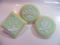Damask Wedding Cookies 2-    Wedding cookie samples with new damask designs. There were done with hand-cut stencils and piped dots. Design inspirations came from damask font characters.