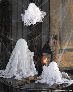 Cheesecloth Ghosts from Martha Stewart We made these cheesecloth ghosts two years ago and loved it.  We plan to make more this year.