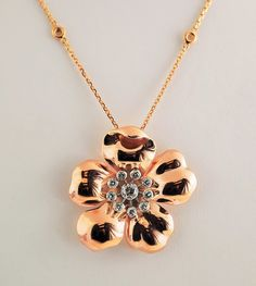 It's spring any time of the year with this pretty pink gold flower pendant with center diamonds.   Large 14k Pink Gold Flower With Diamonds
