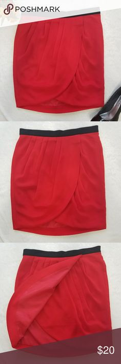 "Banana Republic Designer Red Tierred Skirt Beautiful, elegant-looking skirt from Banana Republic. Perfect for office or semi-formal event. Has concealed zipper with hook and eye closure. Fully-lined.  100% polyester. In EXCELLENT pre-owned CONDITION. No visible flaws or defects. Smoke-free home. Feel free to ask. Approx. Laid Flat Measurements: Waist - 14 1/2"" Length - 18"" (waist to bottom hem) Banana Republic Skirts"