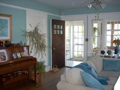 California beach bungalow, A fresh new look for my 1916 craftsman bungalow living room. Sea green walls framed in white wood trim create the...