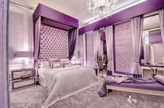 Slight Silvers with Purples Bedroom:I love everything. The hues the decor and designing such as the high tufted bed with the stripe of dark purple near the ceiling and lighter toned purple below,  the tall headboard and walls. This room looks like a room for a young princess.