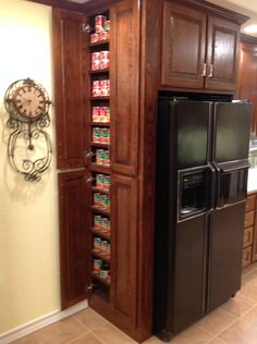 There's room for everything you need with this custom designed cabinet that wraps around the refrigerator.