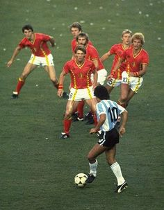 This photograph is probably on a par with Neil Leifer's photographs of Muhammad Ali in terms of how recognisable it is. The irony, as explained in this article, is that Diego Maradona wasn't attempting to take on a posse of Belgium players, as the image seems to imply. It's still a remarkable photograph, though, and one which seems befitting of a player of Maradona's special quality.  Photograph: Steve Powell/Getty Images