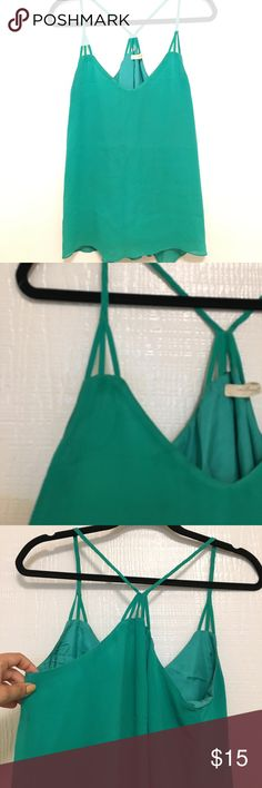 Racerback cami Racerback cami with braided strap detail. Small stain as pictured Chelsea Flower Tops Camisoles