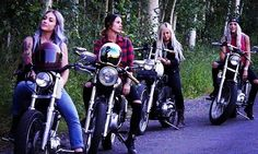 Members of the Litas, based in Salt Lake City, take a break on their bikes.