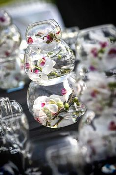 center piece in three tier fish bowls.  just buy three sizes and add phaelenopsis orchids.  The orchids last for days out of water so can be prepared beforehand for a DIY wedding.