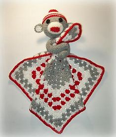 This an original pattern designed by myself to make a crocheted sock monkey lovey.