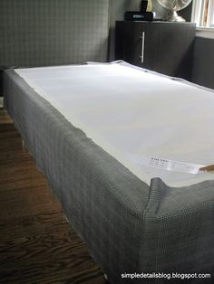 how to cover a boxspring with fabric using an Ikea Sultan Aram Foundation ($100) and Sultan Stainless Legs ($15)