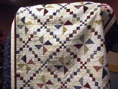 Pinwheel quilt with an Irish Chain found on Quilt Walk Talk page.