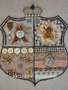 make your own coat-of-arms. this one is by heather bullard.